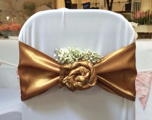Gold taffeta twisted rosette